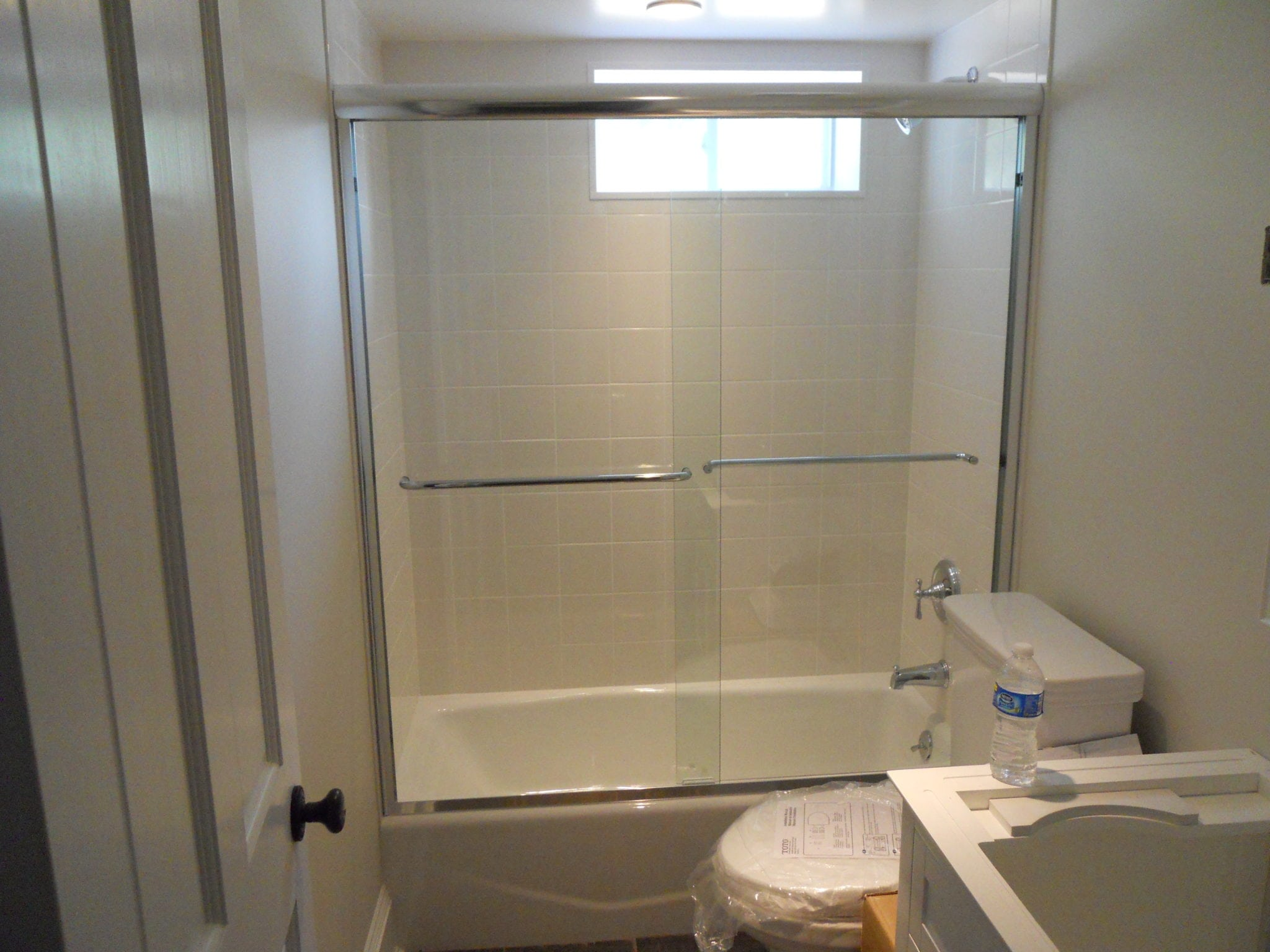 Frameless Double Sliding Tub Enclosure by Absolute Shower Doors