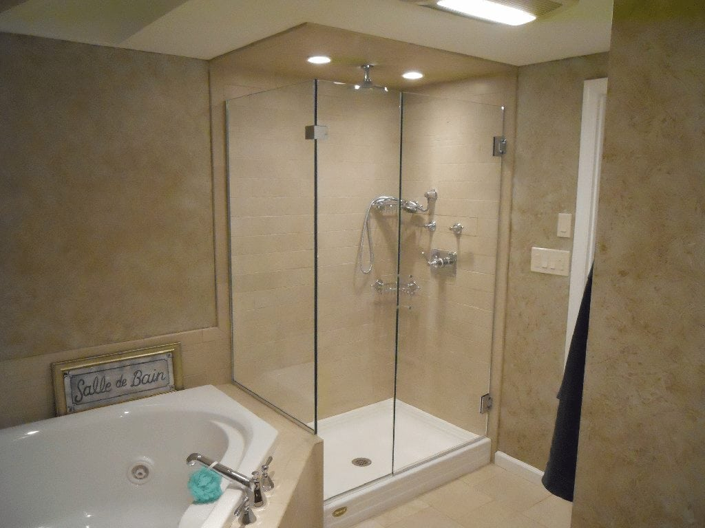 Frameless Shower Corner Enclosure with Return Buttress panel on Tub ...