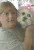 Sandy Spencer and her Lhasa Apso therapy dog, Tobalina-Grace. Lhasa apsos make great Therapy dogs. Lhasa apsos make great agility dogs.  Lhasa apsos make great watch dogs.