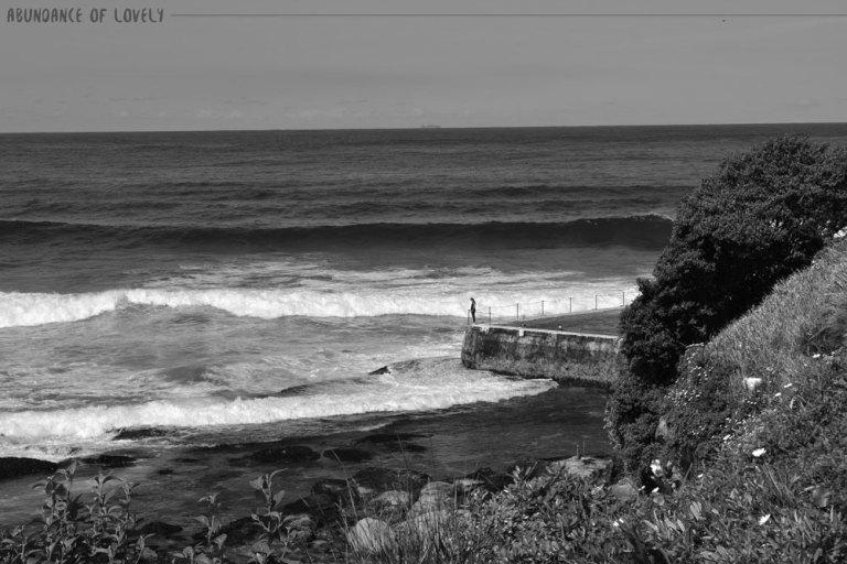 BW-STANDING-ON-EDGE-BEACH