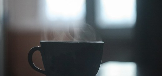 cup of hot beverage sitting on table
