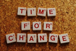 image of tiles spelling Time For Change on a cork background
