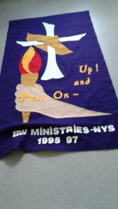 Banner from Jamaica Convention 1995 ... picture of a torch held in a hand, cross and it says Up and Press On