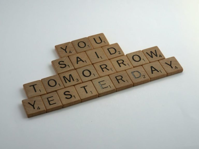 scrabble tiles spelling out you said tomorrow yesterday