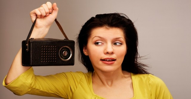 young woman is listening radio