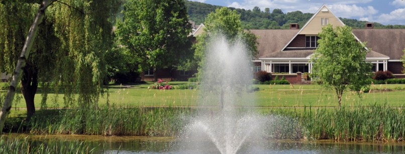 Pond with a beautiful fountain on scenic Acacia Village grounds