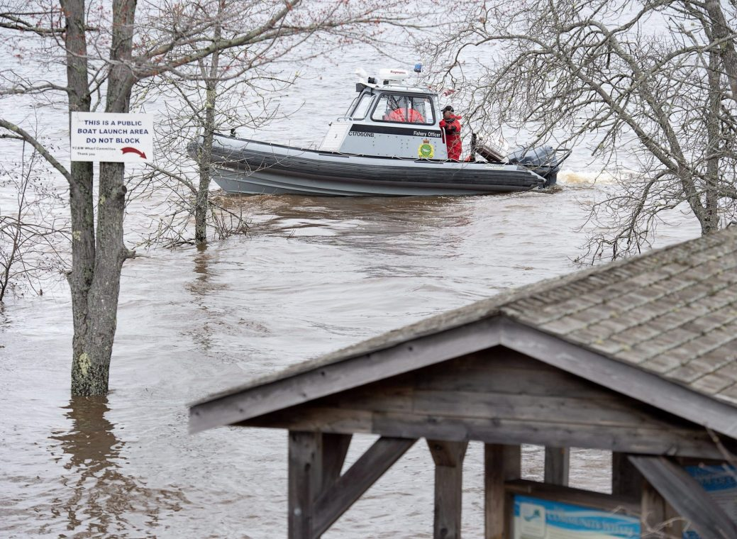 A federal fisheries patrol boat cruises the waters of the Saint John River in Grand Lake, N.B. on Thursday, May 3, 2018. Swollen rivers across New Brunswick are still rising, flooding streets and properties and forcing people from their homes in several communities. THE CANADIAN PRESS/Andrew Vaughan