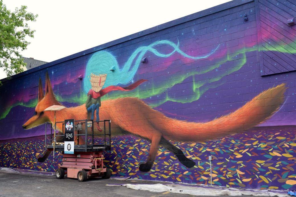 L'œuvre relatant un conte peinte par SENS aux coins des rues High et John. - Acadie Nouvelle: Lili Mercure