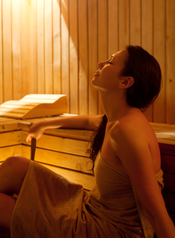 Young woman relaxing in sauna.