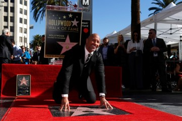 Actor Johnson poses on his star after it was unveiled on the Hollywood Walk of Fame in Los Angeles