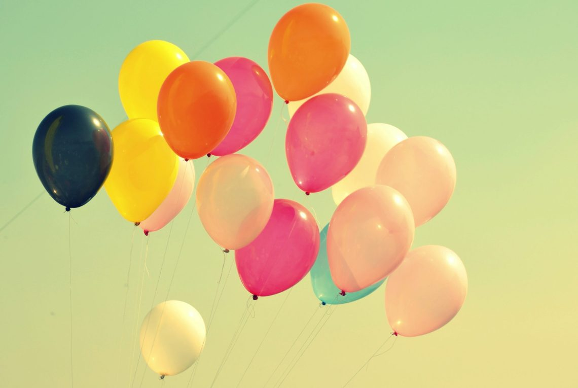 baloons floating in the sky
