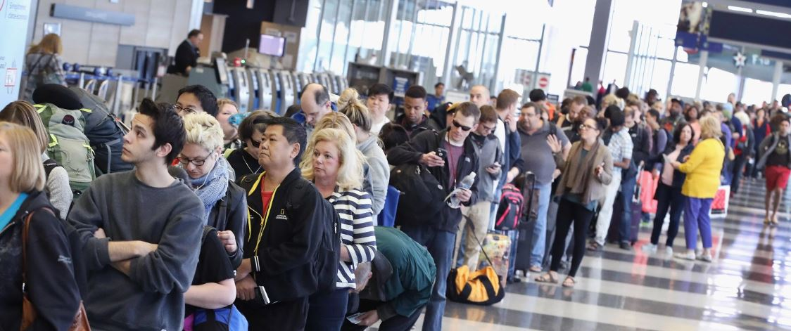 holiday travelers wait in airport amid germs