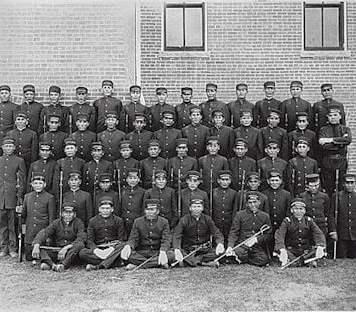 Early Albuquerque Indian School class of young men in uniform