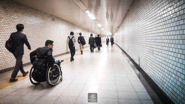 Saba is wheeling along the subway walking path