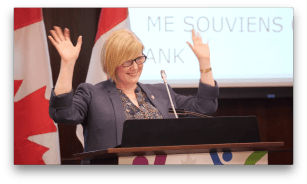 Minister Qualtrough raising her hands on victory at the Accessible Canada Act Reception