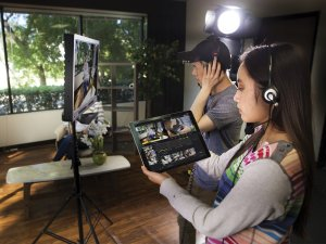 two people video blogging or vlogging to an ipad live