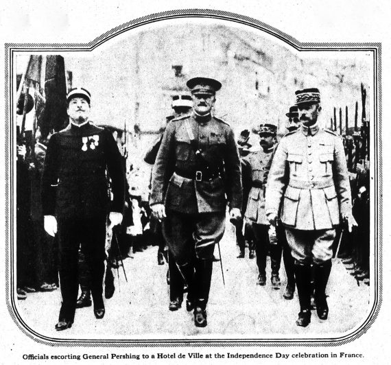 Officials escorting General Pershing to a Hotel de Ville at the Independence Day celebration in France