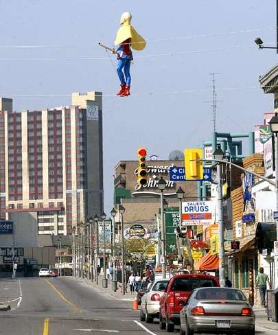 Blondin on tightrope over Victoria Avenue in Niagara Falls