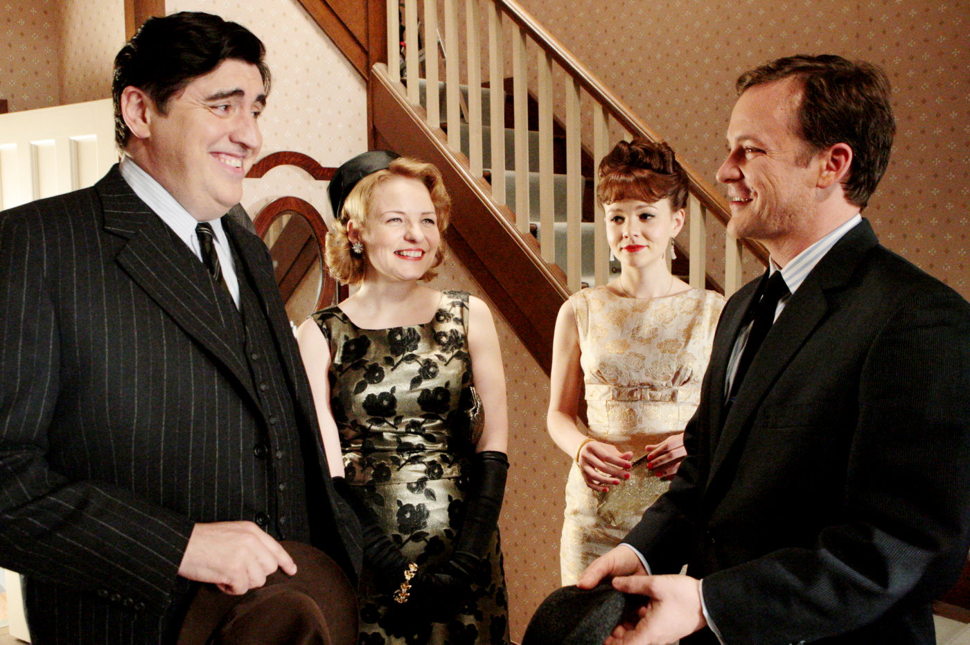 Alfred Molina, Cara Seymour, Carey Mulligan, and Peter Sarsgaard in An Education