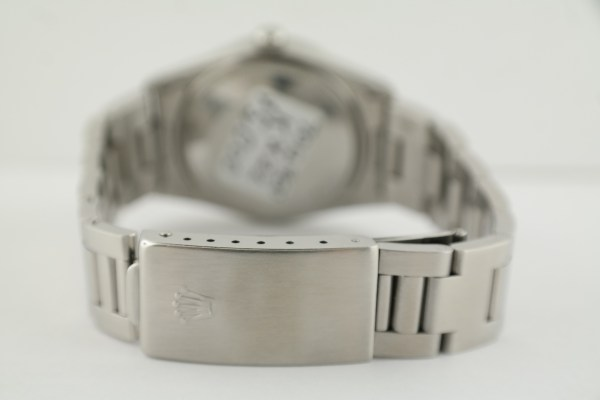 Men's Rolex Date 15010 White Roman Doorstep Dial Engine Turned Bezel Oyster Band