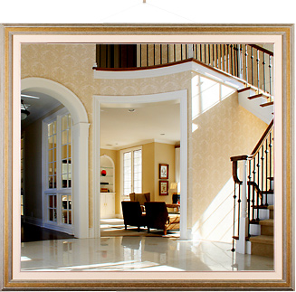 photo of beautiful foyer with wrap around stairway to second floor