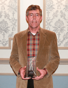 photo of James Acheson holding 2014 Keppler Award for Remodeling Achievement