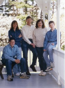 group portrait photo of family of five on porch