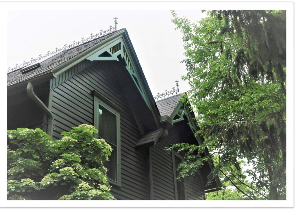 Dramatic double roof line with fancy Victorian trim and ridge adornments.