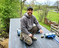 Robin working on a roof for Acheson Builders.