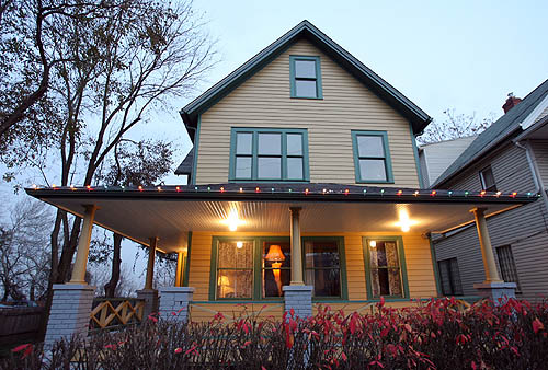 A Christmas Story House with Leg Lamp Shining