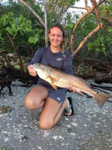 Girl holding redfish