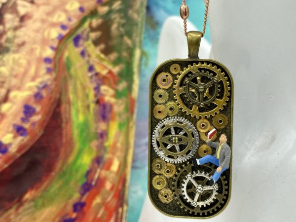 Diorama necklace with gears