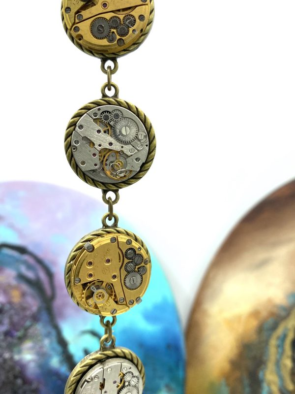 Steampunk Bracelet with gold and silver colored mechanisms