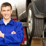 Happy Car Mechanic Holding Wrench Acirne