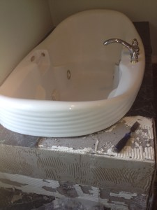 These photos show the process of dismantling an existing bathroom which had black marble tile with an old leaking Jacuuzi tub. It was replaced with a soaker tub which is free standing & large floor mounted faucet.