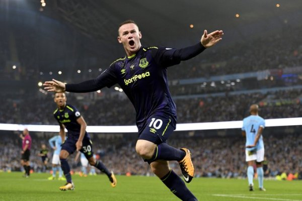 City held by Everton, as Rooney makes history