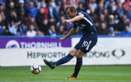 Premier League: Kane double help see off Huddersfield