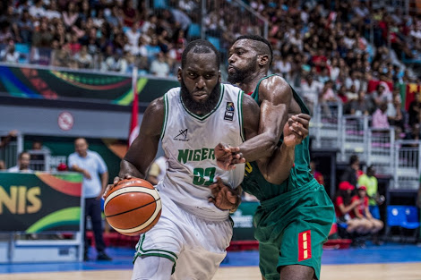Boston Celtics sign D'Tigers centre Ochefu