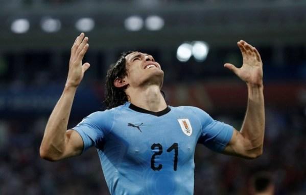 Russia 2018: Cavani stars as Ronaldo joins Messi