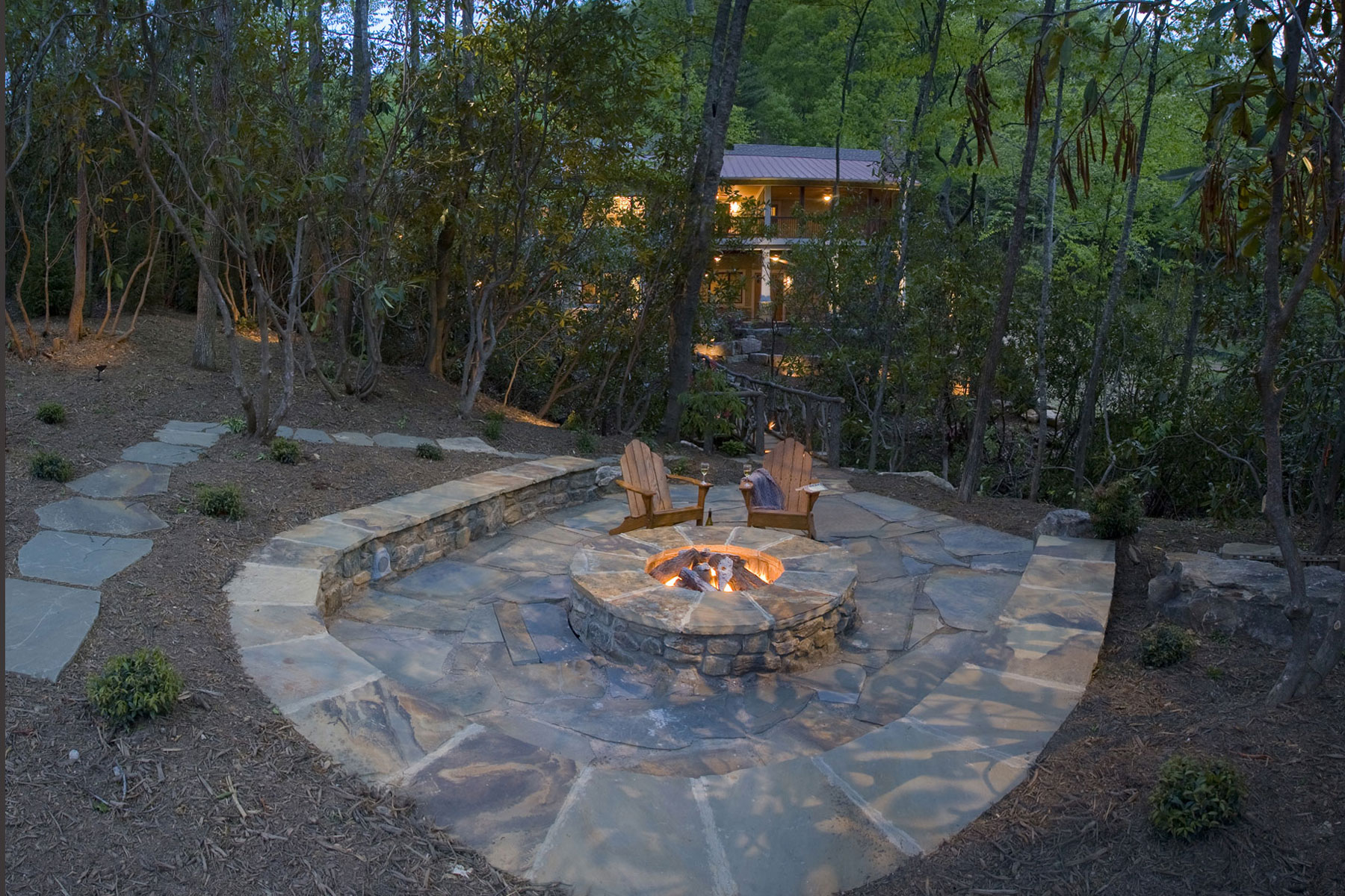 Backyard stone patio with firepit and raised wall for ... on Backyard Patio With Firepit id=68000