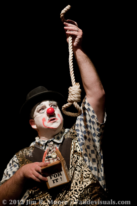 Clown contemplating hanging himself photo