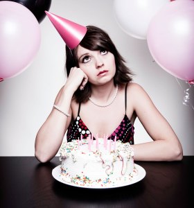 Photo of a young woman alone at a party