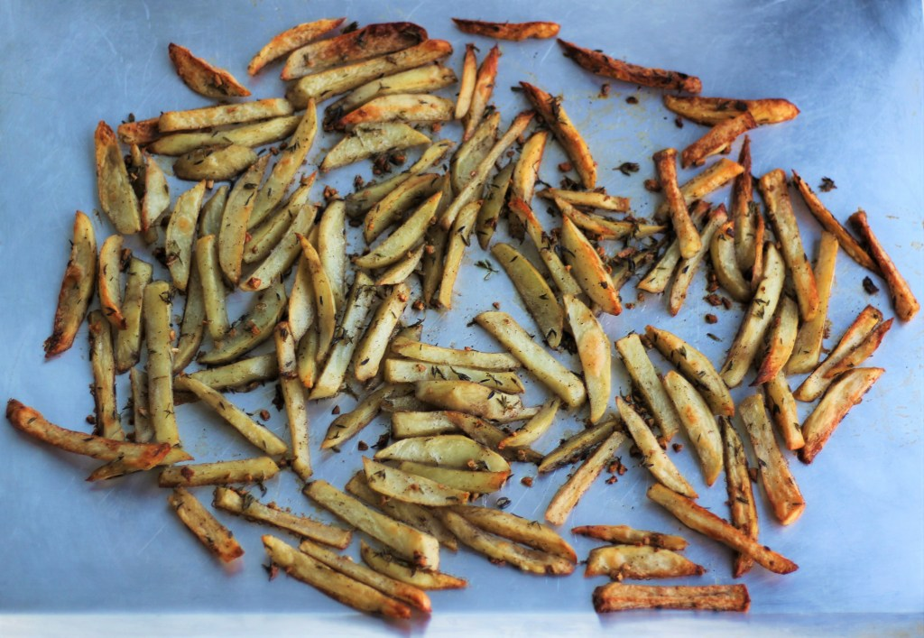 Garlic- and Thyme-Tossed Fries on baking sheet