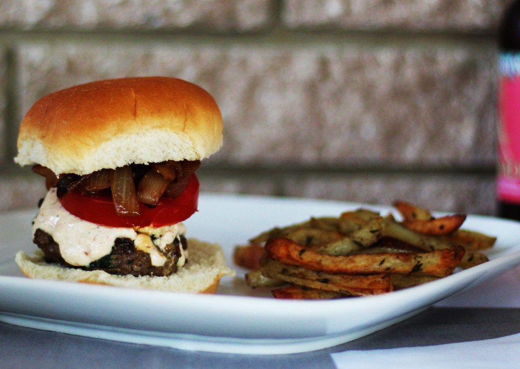 Lamb Burgers with Sauteed Onion and Garlicky Feta Sauce – and Garlic- and Thyme-Tossed Fries - close-up