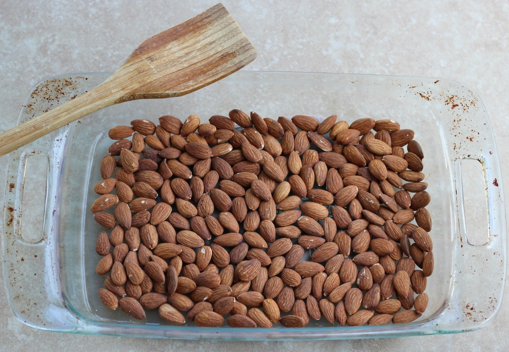 Oven-roasted almonds in a baking dish