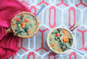 Two crocks of Creamy (Dairy-Free) Sweet Potato, Kale, and Cannellini Bean Soup
