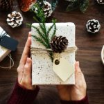 Festive gift, wrapping paper, pine cone, holly