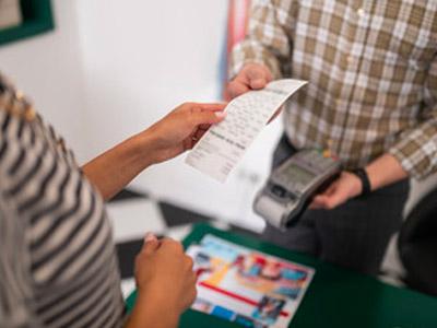 receipt in hand