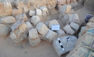 Inscripted block (lower right) as found in 'Ayn Gharandal gate area. Photo Darby 2013.