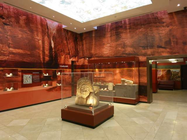 This room from the new Petra visitors' center exhibition showcases artifacts that shed light on Nabataean religion and cult. Photo by Glenn J. Corbett.